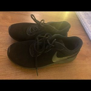 All black nike sneakers. Size 5 youth.